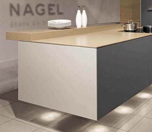 n this kitchen concept, the suspended cooking island was made in aluminium and glass. The worktop of this individual kitchen is made of artificial stone and is lighted indirectly.